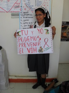 Because Pasos Adelante addresses sexual health topics, we decided to plan a big event around World Aids Day on December 1st. Here, Angeles holds the sign she made for our parade through the streets of Olmos.
